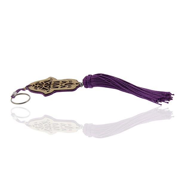 Porte cles main de fatima en bois et pompon en soie Violet