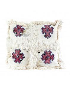 https://moroccodeco.com/coussin-vintage-berbere-en-laine-vierge-tisse-main-blanc-motifs-roses-et-rouges