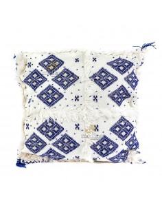 https://moroccodeco.com/coussin-design-berbere-en-laine-vierge-tisse-main-blanc-et-bleu